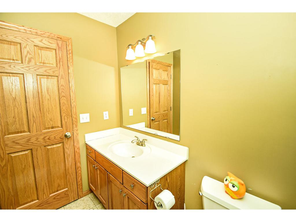 Upper level main bath.  All doors in the home have six panels and are oak.