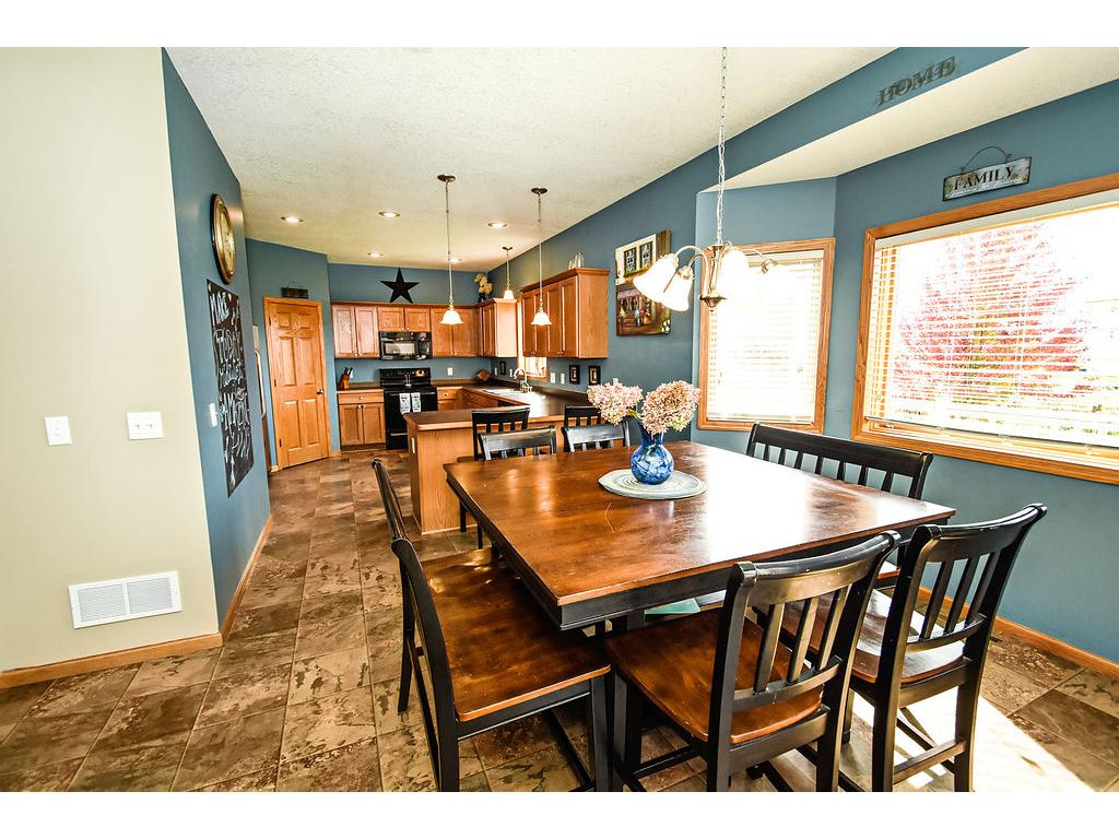 Spacious kitchen has a pantry closet and good sized dining area.