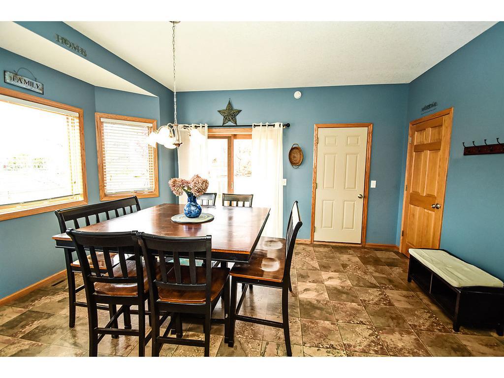 Good sized eating area.  Sliding door leads to the deck.  Door to garage and door to lower level.