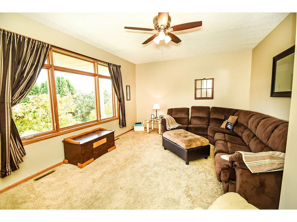 Spacious living room with large picture window.