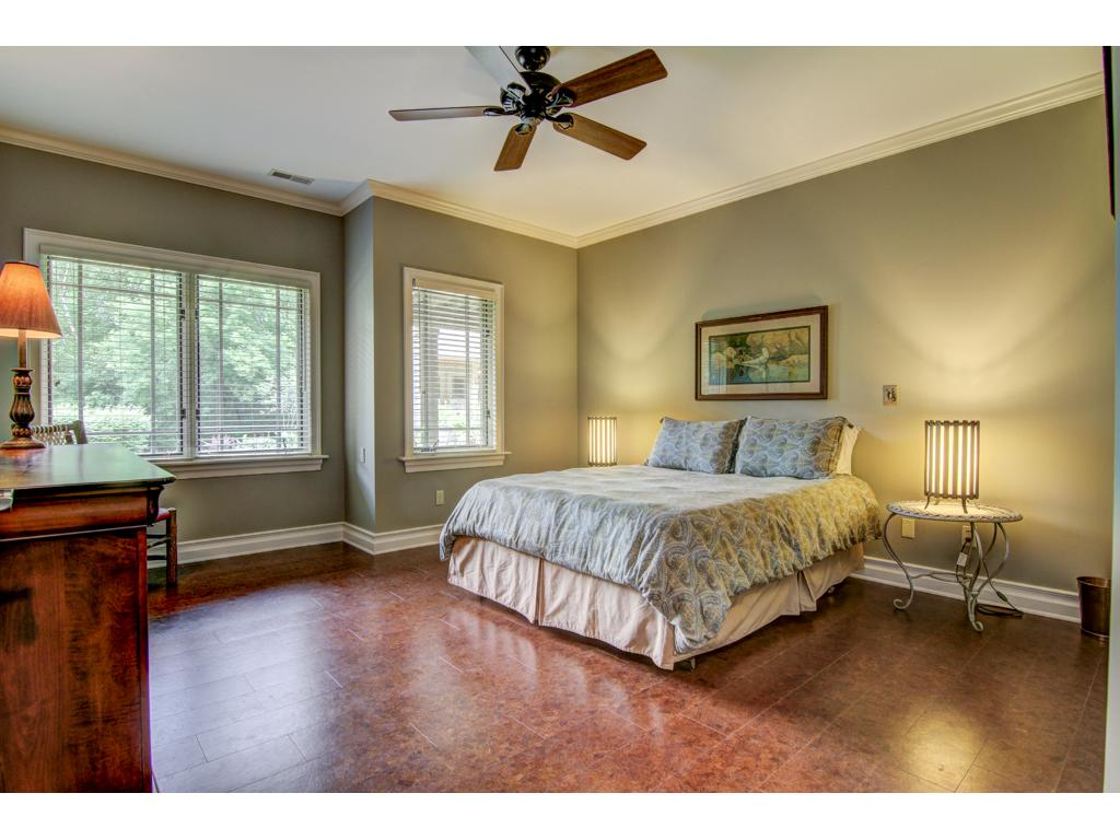 One of two spacious lower level bedrooms look out over the gardens.