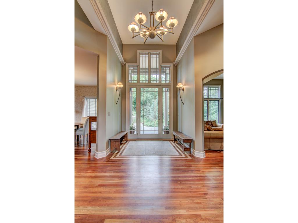 Enter from the stamped concrete circular driveway complimented with a beautiful fountain and gorgeous perennial gardens, through the doors to be greeted by new gleaming cherry hardwood floors.