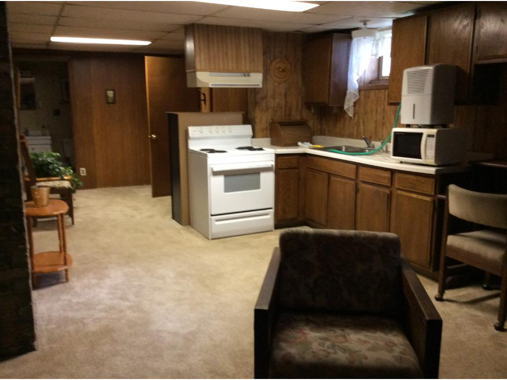 Finished lower level has a kitchenette, 3/4 bathroom, an office/ den, and can have an additional bedroom