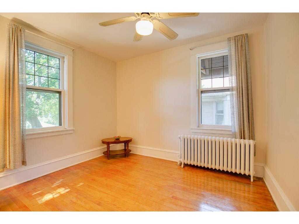 Lovely upper level first bedroom features gleaming hardwood floors!