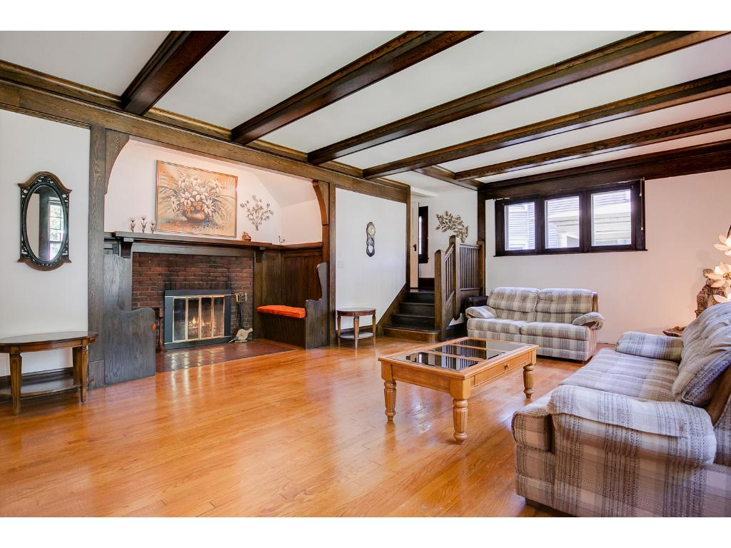 The living room also features a cozy wood-burning fireplace!