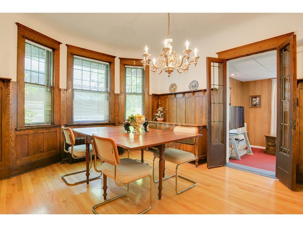 Wonderful main floor dining room features beautiful woodwork, hardwood floors, and built-ins!