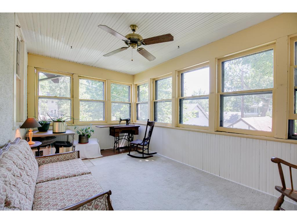Spacious upper level sun room with a ceiling fan!