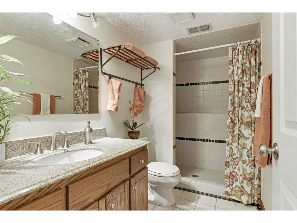3/4 Bathroom with New Granite Counter, New Sink and Vanity, New Light and Faucet, and large Shower!