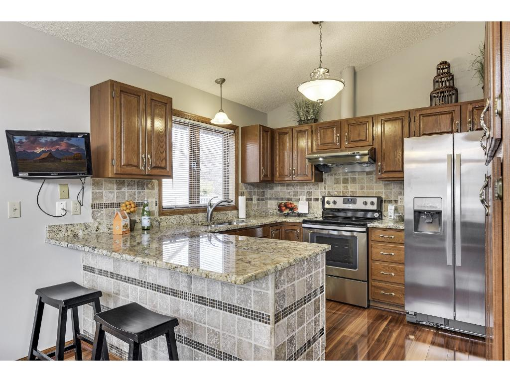Completely updated Kitchen with BRAND new Stainless Steel Appliances, as well as Granite Counters, Tiled Backsplash, and counter seating!
