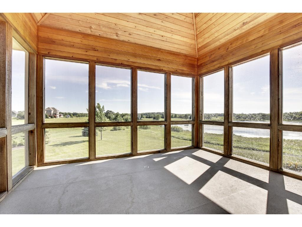 Main level screened porch with pond view.