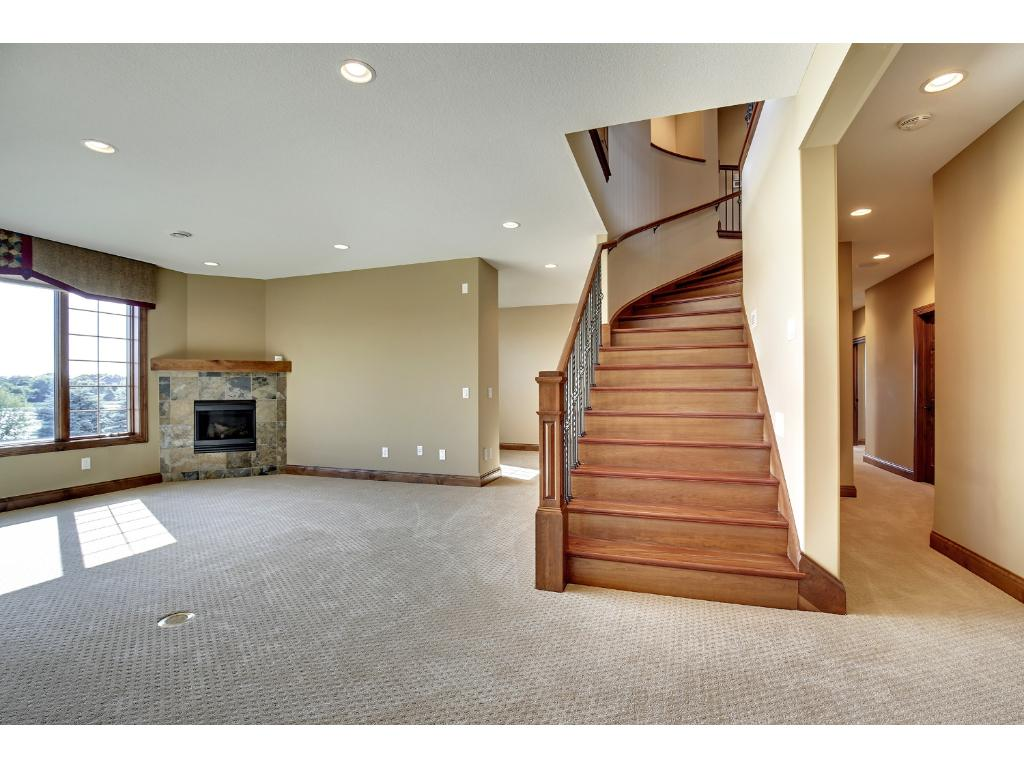Lower level family room with gas fireplace. Walk out to the pool and back yard.