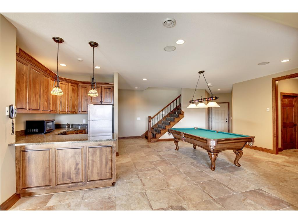 Lower level game area with full bar and billiards room.