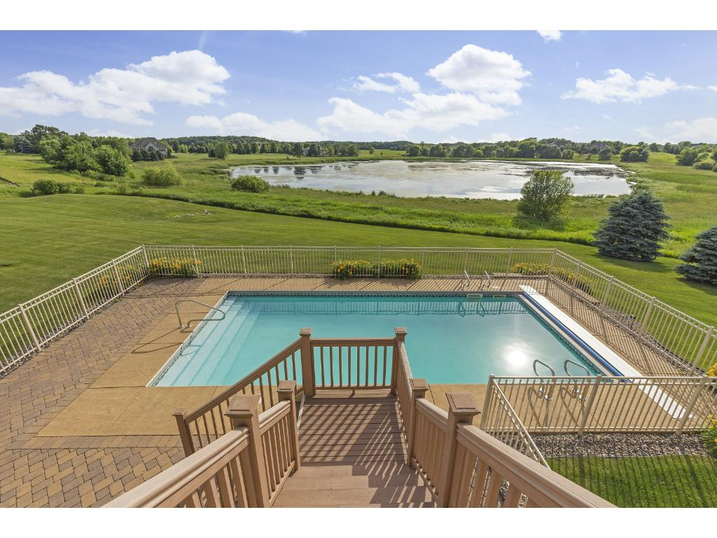View of your back yard pool. You will have many hours of fun with the pool, patio, hot tub and huge back yard!