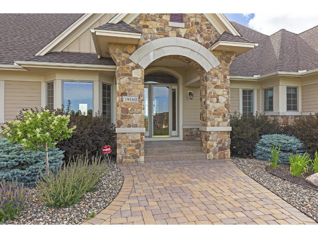 Inviting front entry has covered area to keep your guests dry and a large airlock to keep your foyer warm.