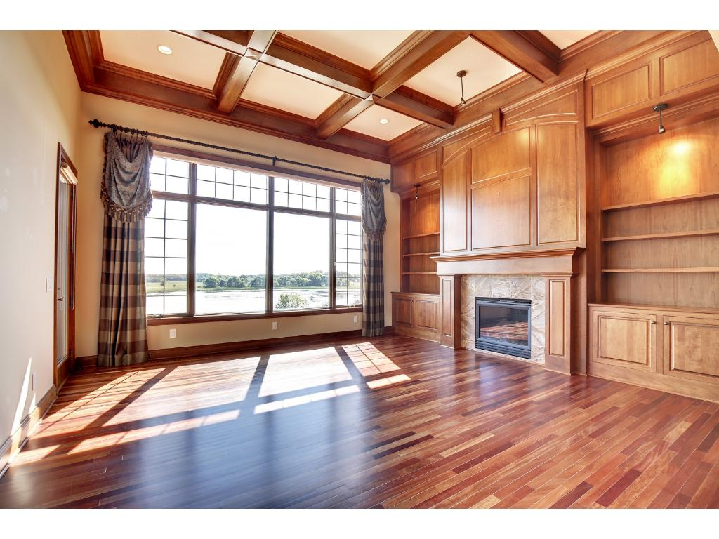 Living room with Brazilian cherry floors, gas fireplace, 14' coffered ceiling and beautiful view!