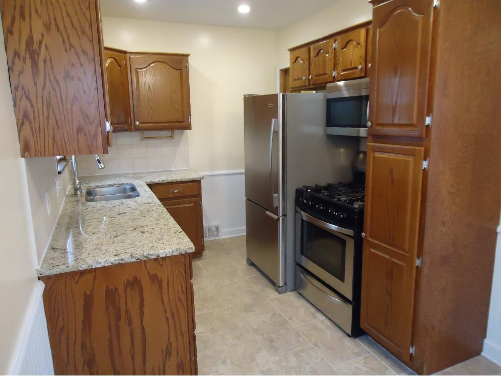 THE REMODELED KITCHEN BOASTS NEW GRANITE COUNTERS+STAINLESS STEEL SINK+MOEN FAUCET+FLOOR+STAINLESS STEEL APPLIANCES; RAISED PANEL OAK CABINETS, PANTRY CABINET WITH SLIDE-OUT SHELVES, CERAMIC TILE BACKSPLASH, RECESSED LIGHTS AND POCKET DOORS.