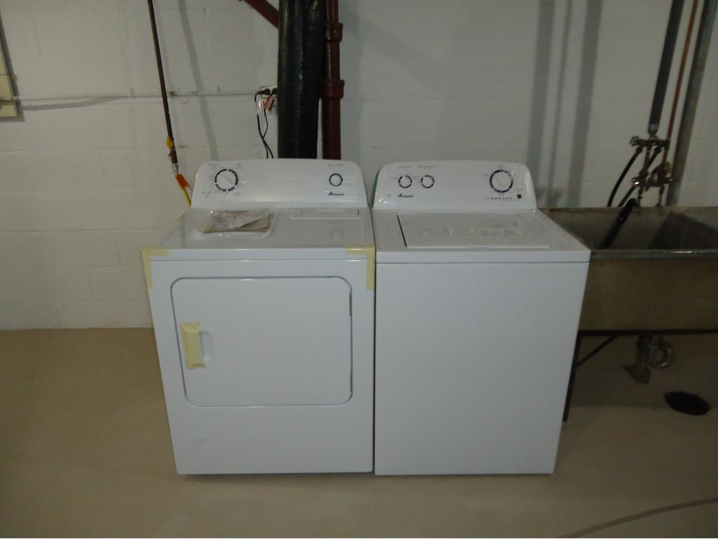 NEW AMANA WASHER AND DRYER.