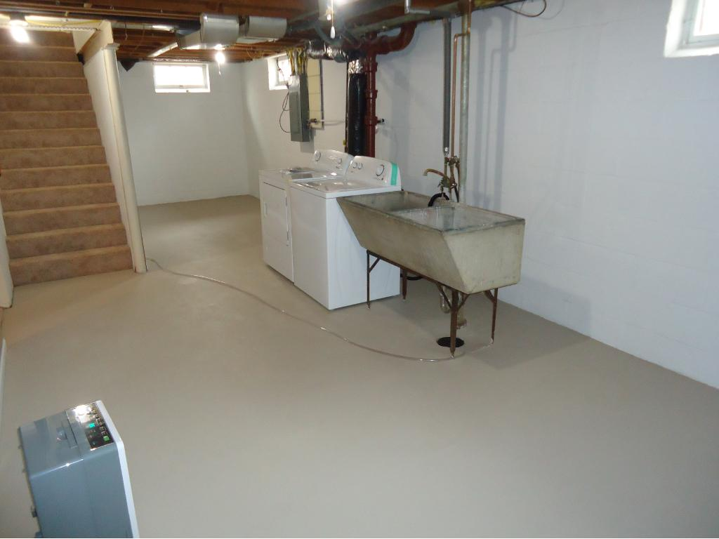 A VIEW OF THE LAUNDRY AREA AND STORAGE AREA.
