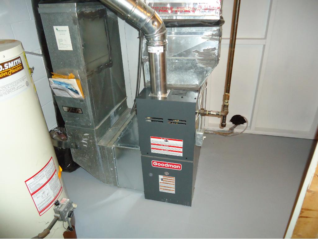 UTILITY ROOM INCLUDES A NEW GOODMAN FURNACE-2014; A.O. SMITH 40 GALLON HOT WATER TANK AND STORAGE SHELVES.