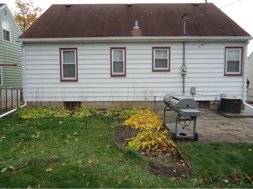 THE BACK YARD IS FENCED AND HAS A PATIO AND LENNOX CENTRAL AIR UNIT.