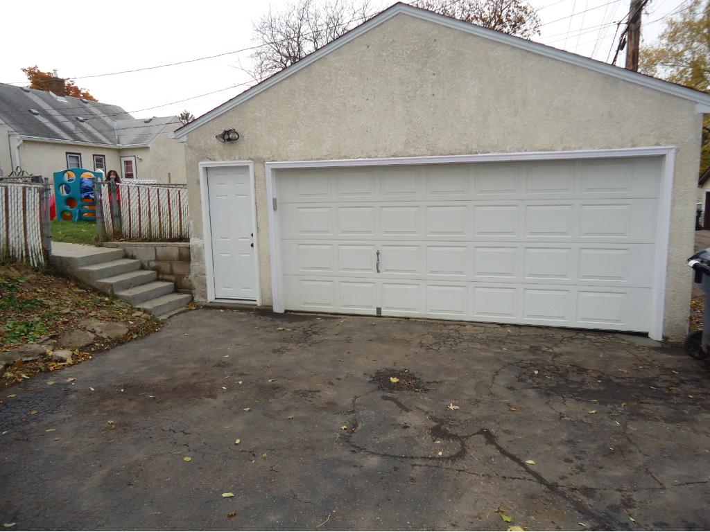 THE OVERSIZED 2 CAR GARAGE INCLUDES A NEW SERVICE DOOR-2016; CRAFTSMAN OPENER-2012; STUCCO EXTERIOR AND EXTRA PARKING PAD.