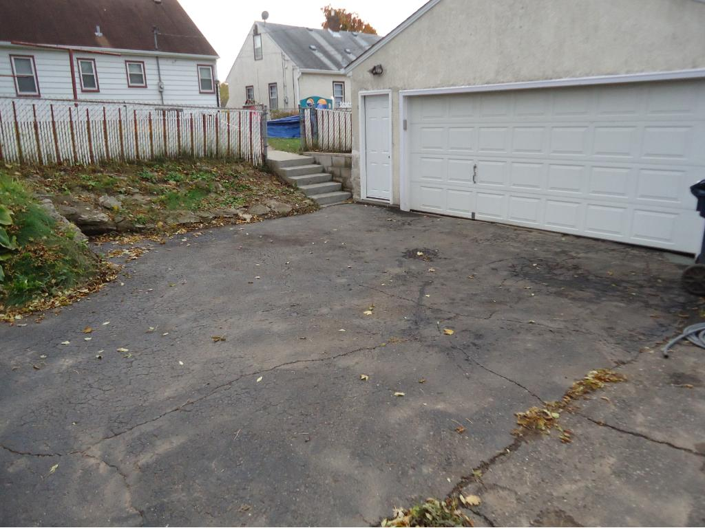 ANOTHER VIEW OF GARAGE AND EXTRA PARKING.