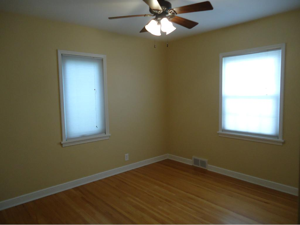 THE 1ST BEDROOM INCLUDES A HARDWOOD FLOOR AND CEILING FAN.