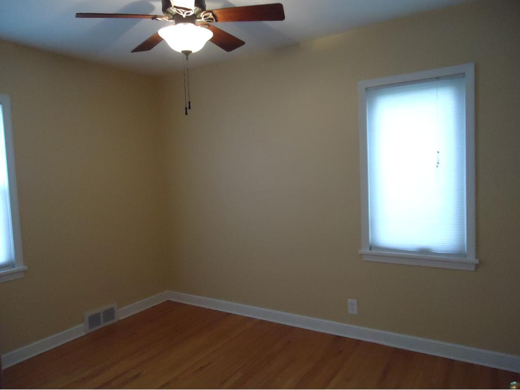 THE 2ND BEDROOM INCLUDES A CEILING FAN AND HARDWOOD FLOOR.