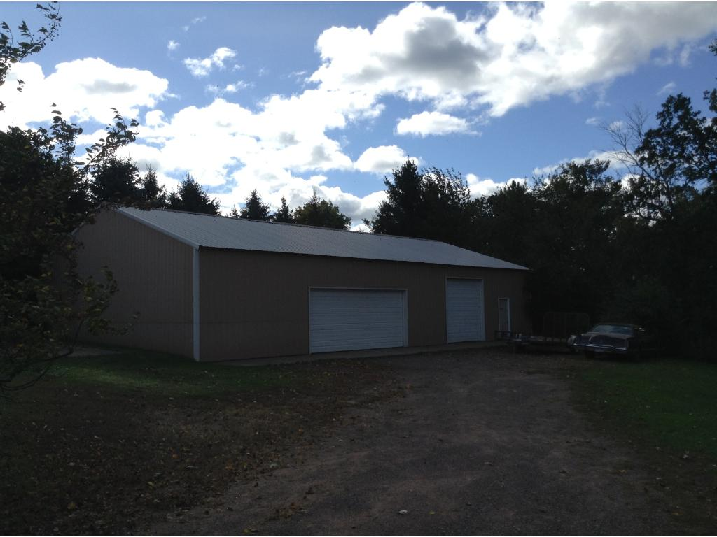 Huge 68x40 pole shed with 28x18 basketball court just to the left