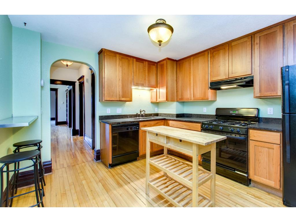 Updated kitchen with granite counters, newer cabinets and appliances and moveable butcher block island.