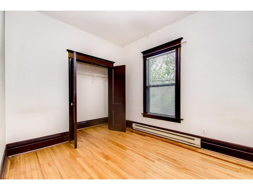 2nd bedroom with ceiling fan and gorgeous hardwood floors.