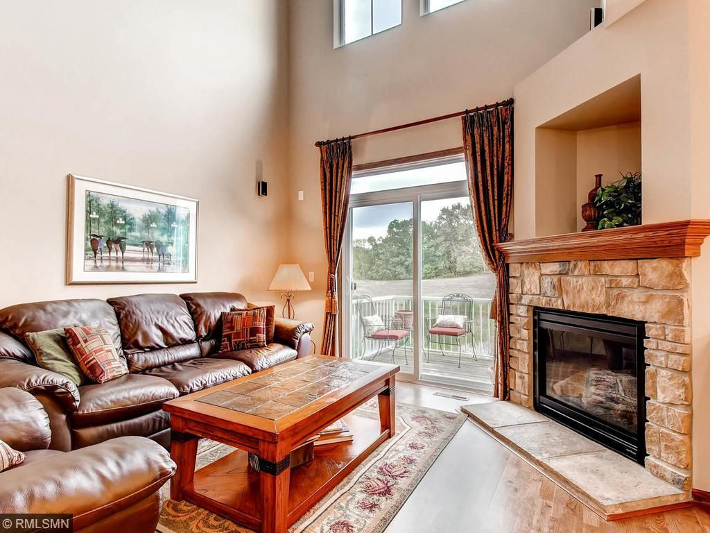 Wood floors throughout the main floor, loads of natural light, and gas fireplace