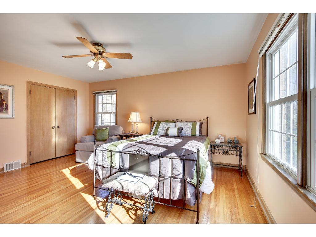 The Main Floor Master Bedroom features Hardwood Floors & Private Views of the Back Yard...