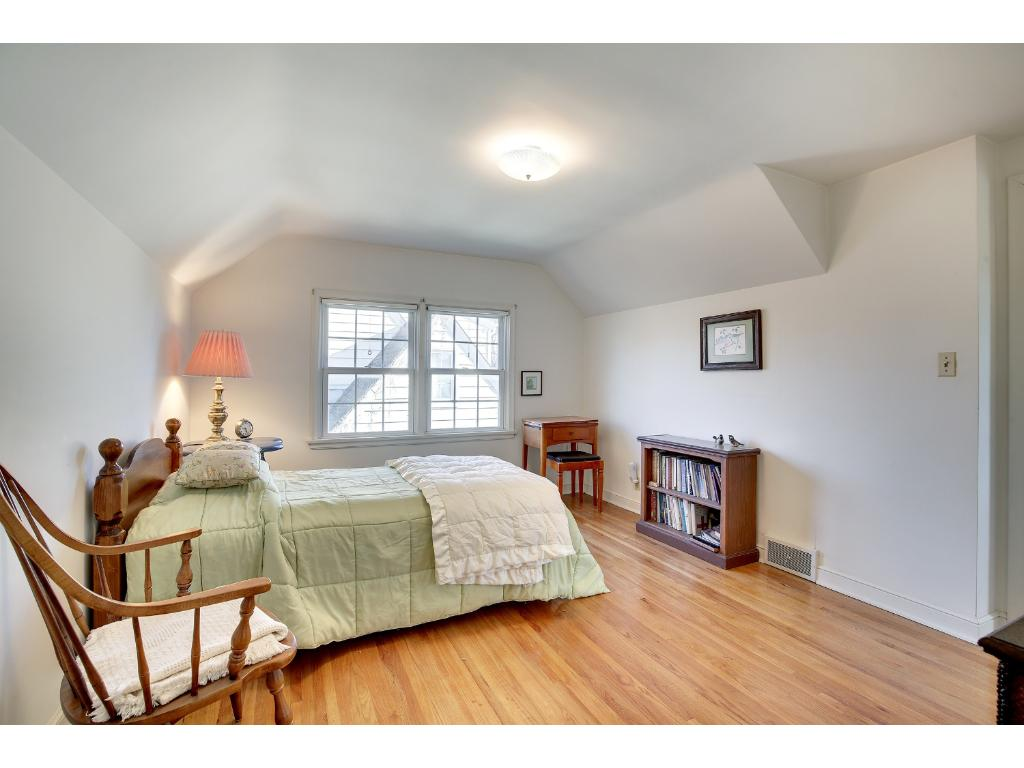 The Upper Level features Two (2) Spacious, Light-Filled Bedrooms. Both Bedrooms feature gleaming Hardwood Floors!