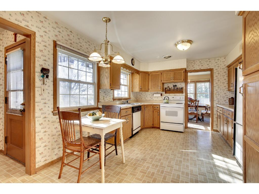 The EXTRA CHARMING Kitchen offers plenty of Cabinet Space & Views of the Private Back Yard.