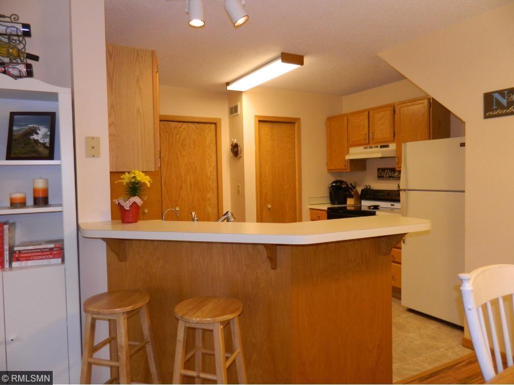 Kitchen area with breakfast bar.