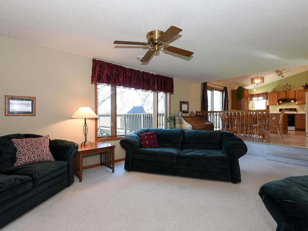 Sunken living room with ceiling fan.
