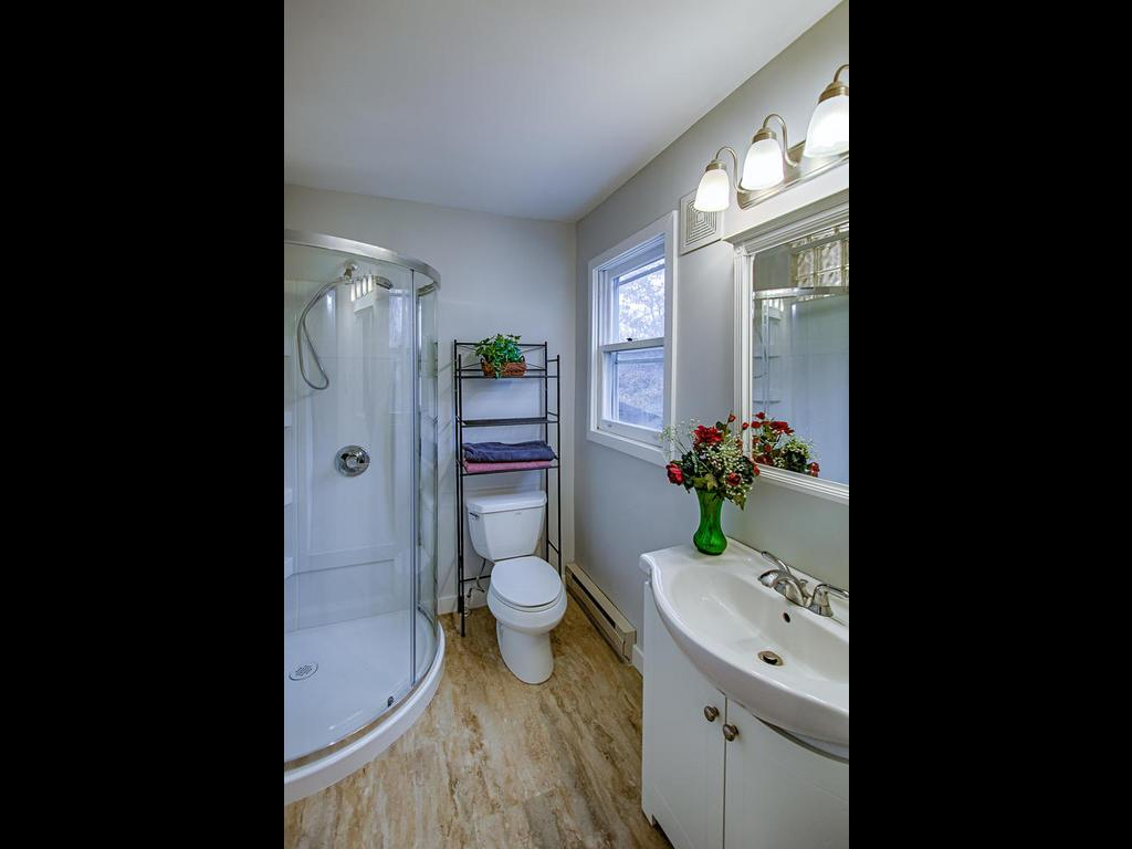 Master bathroom with walk in shower stall