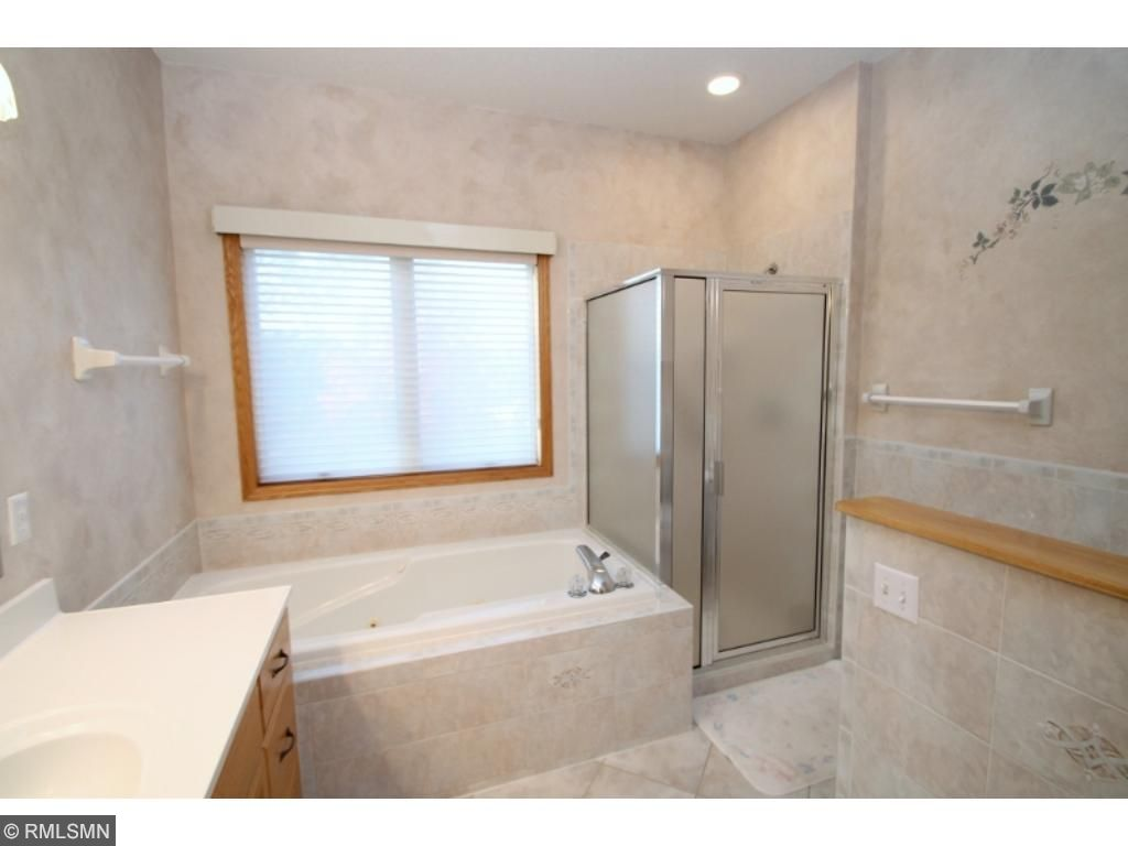 Wonderful master bath suite has double vanity, tub, separate shower and large walk in closet...