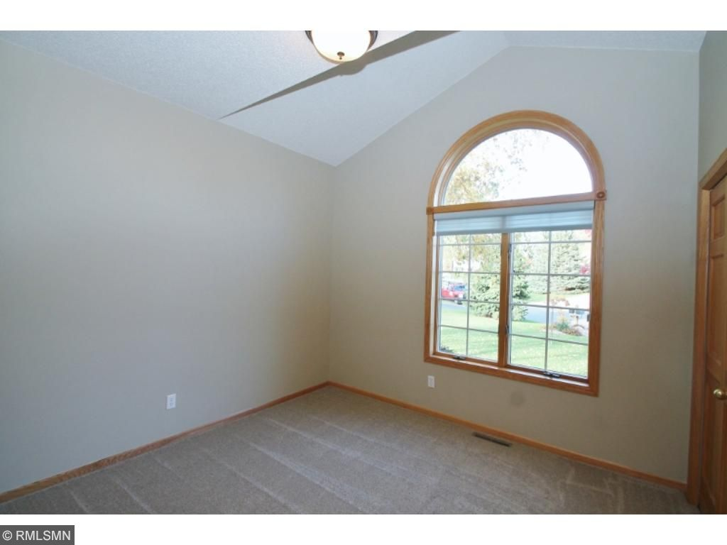Bedroom two has a partially vaulted ceiling and large window towards the street...