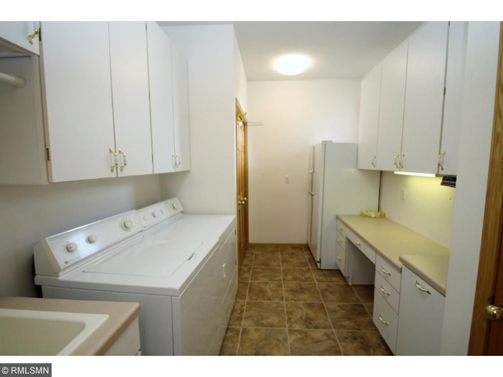 Main level laundry room has additional storage for busy families...