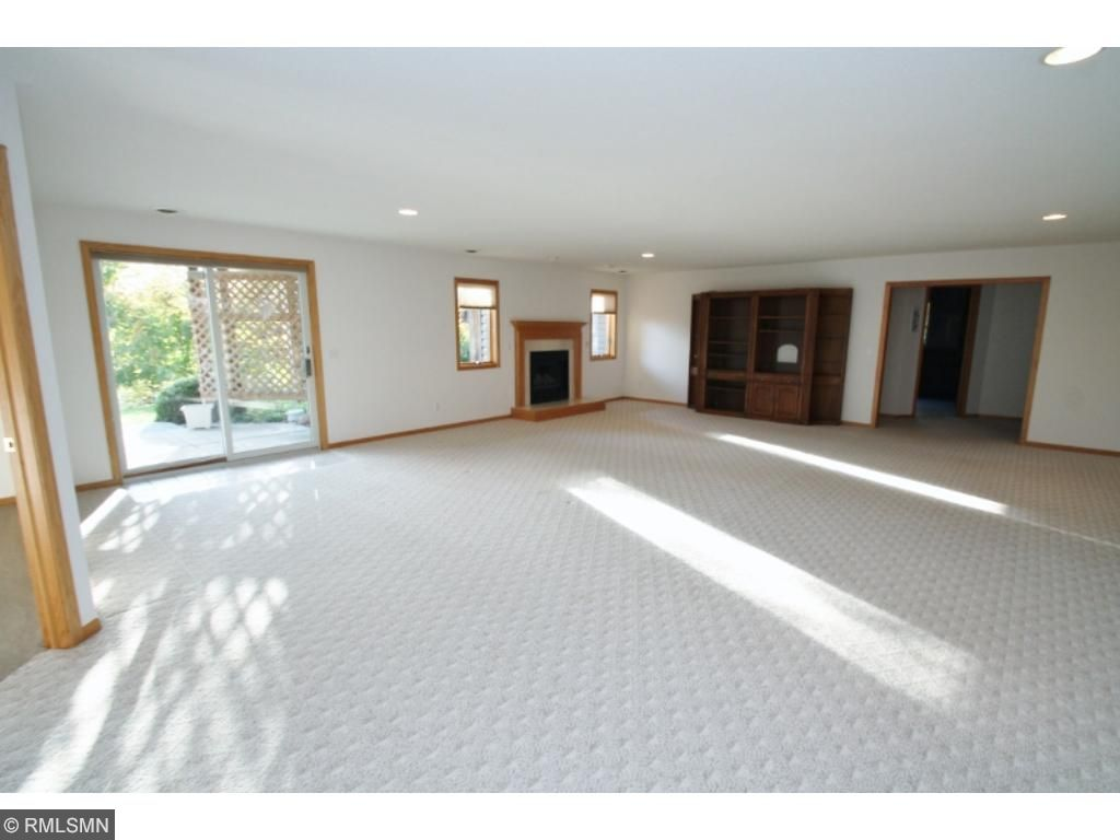 Massive recreation room has fireplace and walks out to private back yard and patio...