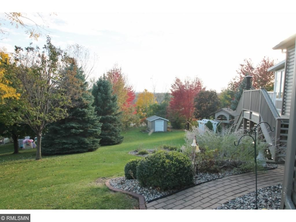 Park like setting in the side and back yard with wonderful flowers, shrubs and trees...