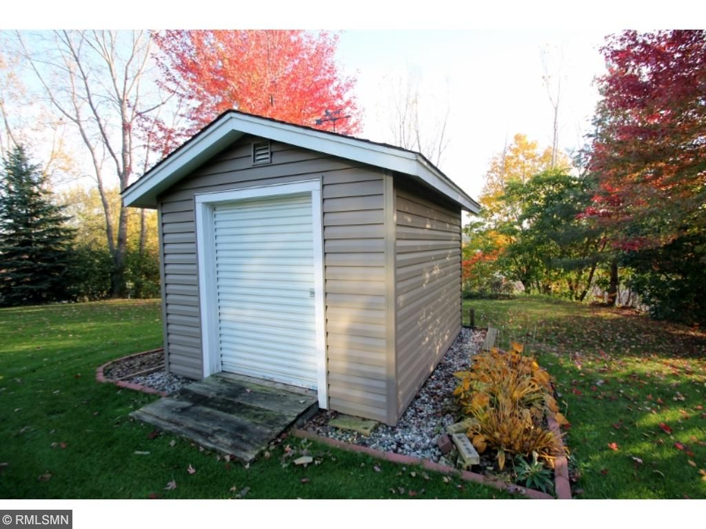 Neat little storage shed leaves the main garage for toys and hobbies...