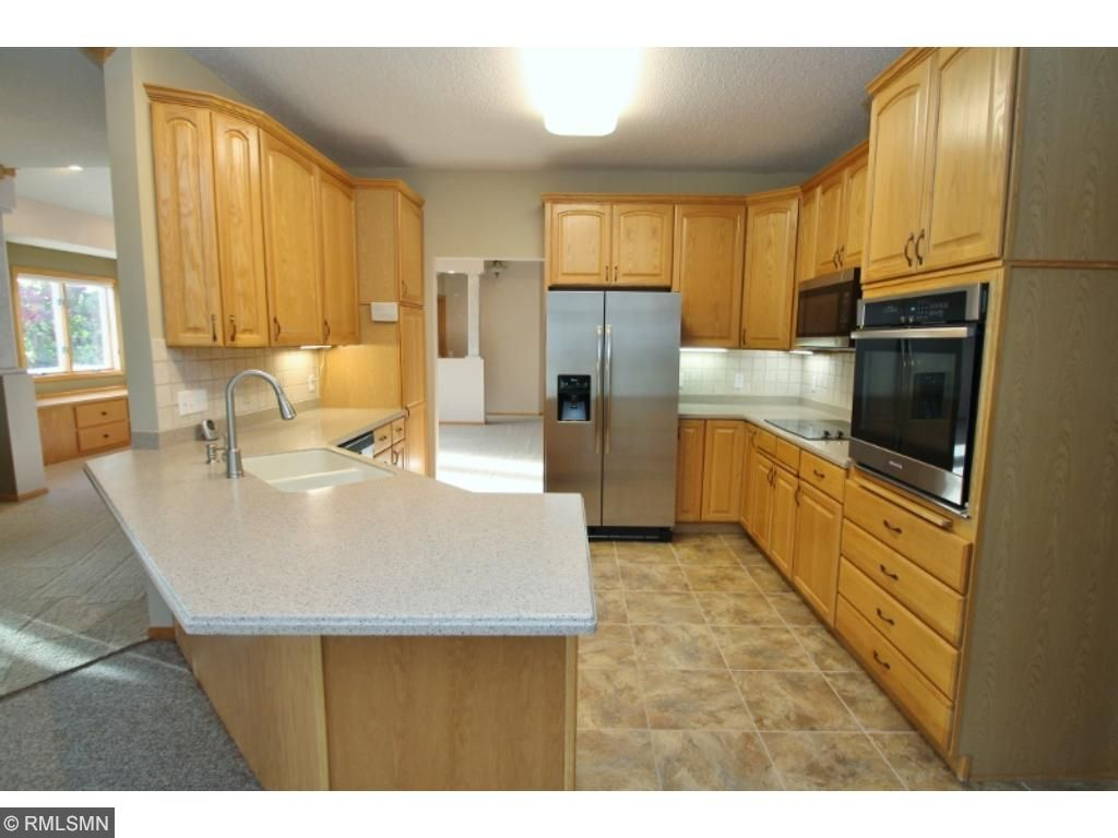 Updated kitchen has new stainless appliances, Corian counter tops and raised panel cabinets...