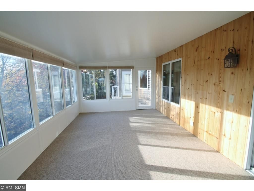 Huge 3+ season porch spans the back of house and offers fantastic views...
