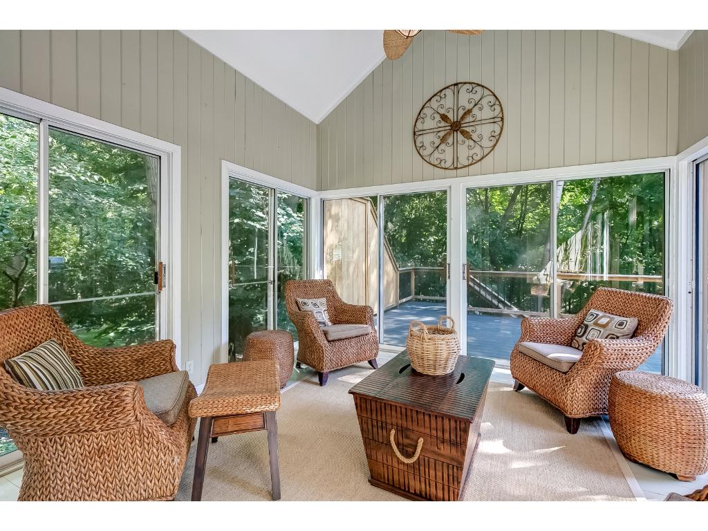 Relax in the 4-season porch with wooded views.