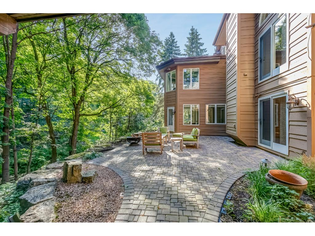 The lower level walks out to this tranquil paver patio.