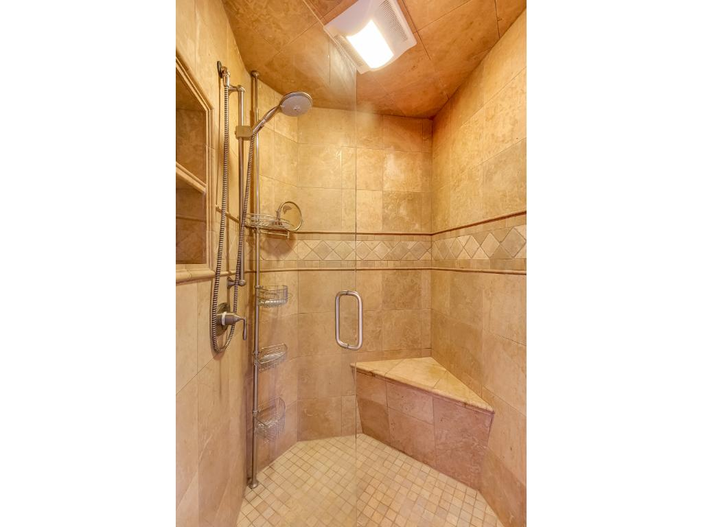 Separate tub and shower - beautiful tile work.