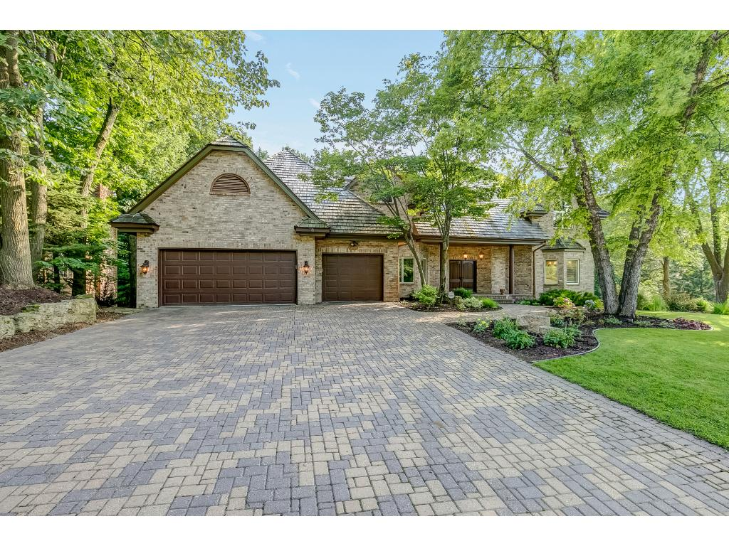 This executive 2-story home is situated on a private wooded lot in a great location just minutes to downtown Excelsior.